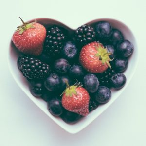 A heart-shaped bowl of fruit; we put your heart health first at KV Drugs.